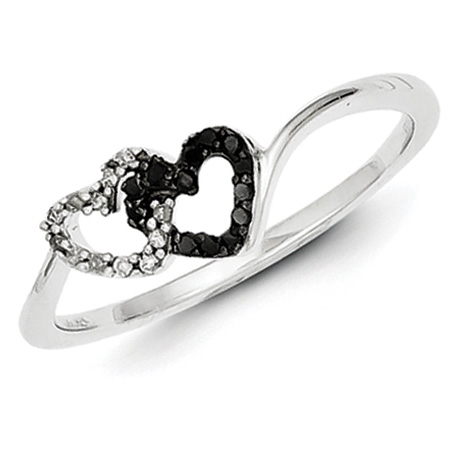 Heart shaped promise ring with black and white diamonds