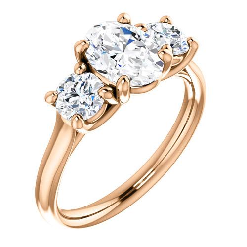 2.1 ct tw Forever One Oval Moissanite 3-Stone Ring 14k Rose Gold