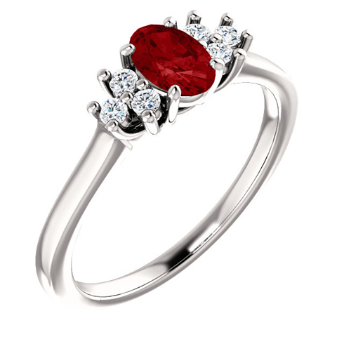 14kt White Gold 3/5 ct Oval Ruby and 1/8 ct Diamond Ring