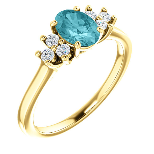 14kt Yellow Gold 1.25 ct Oval Blue Zircon and 1/5 ct Diamond Ring